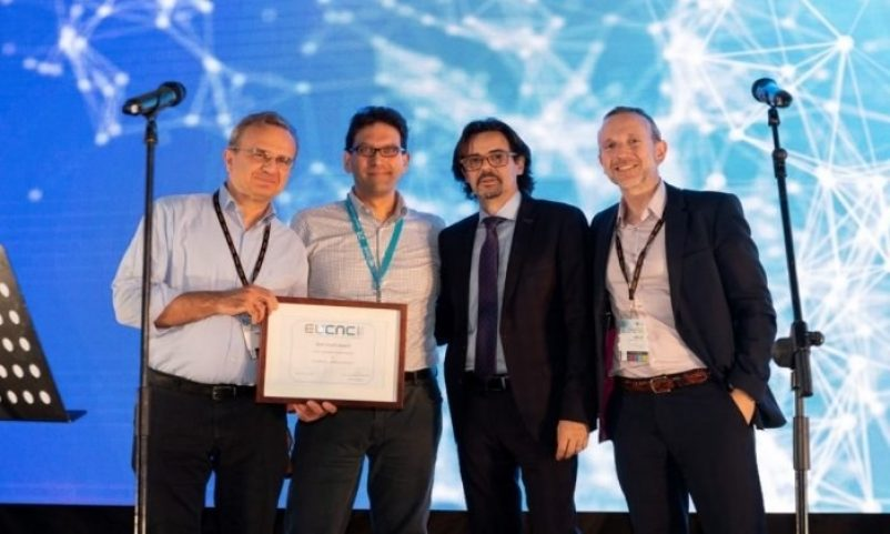 P. Demestichas (1st from the left), WINGS ICT Solutions and 5G-MOBIX partner, receives the Best Booth Award at EuCNC 2019