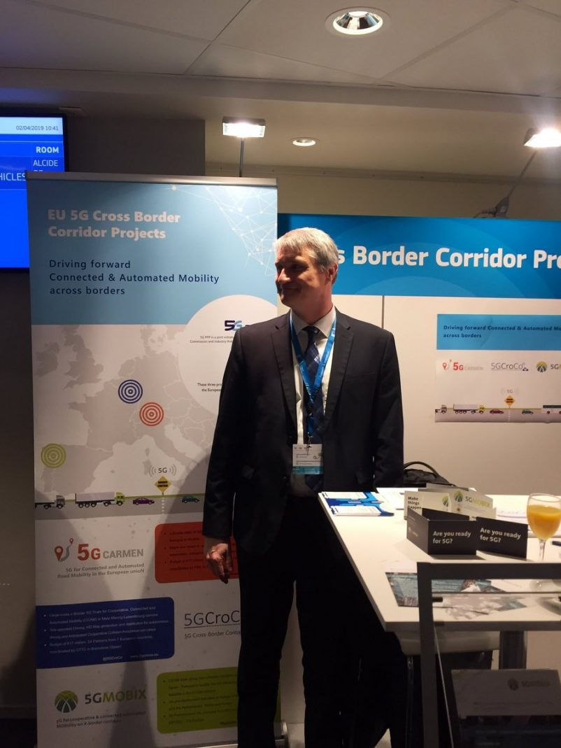 Francois Fischer, 5G-MOBIX project coordinator in from of the 5G-MOBIX stand
